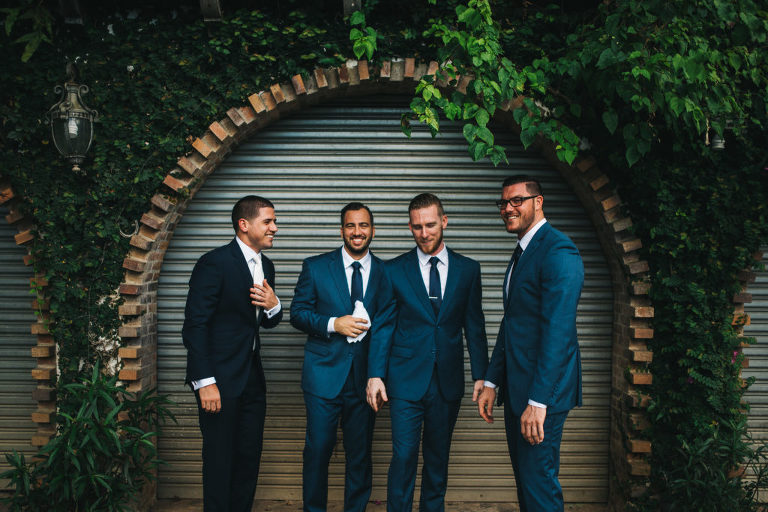 candid groom and groomsmen portrait