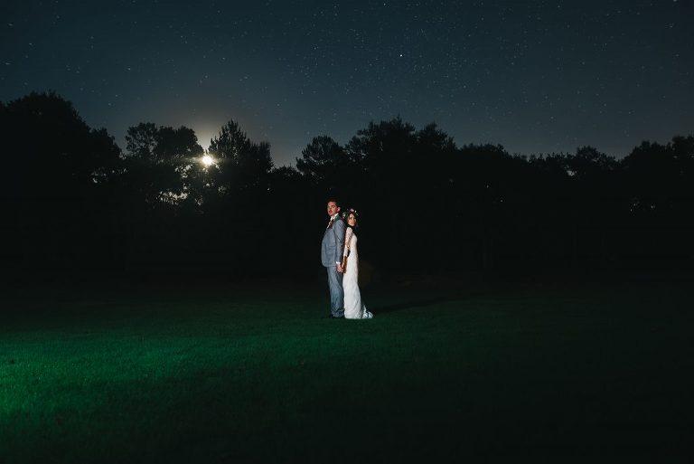 night time star portrait in bramble tree estate during their wedding reception