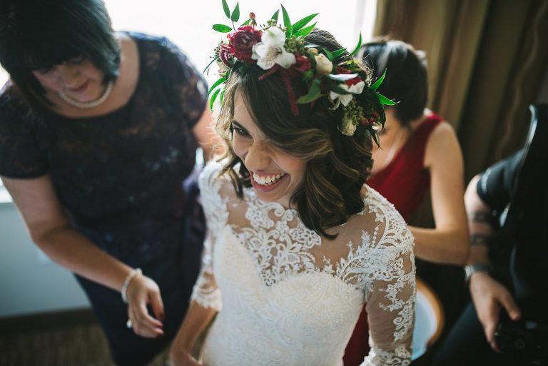 bride getting ready floral crown wedding dress