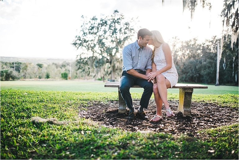 engaged couple sharing an intimate moment near the tower in bok tower gardens
