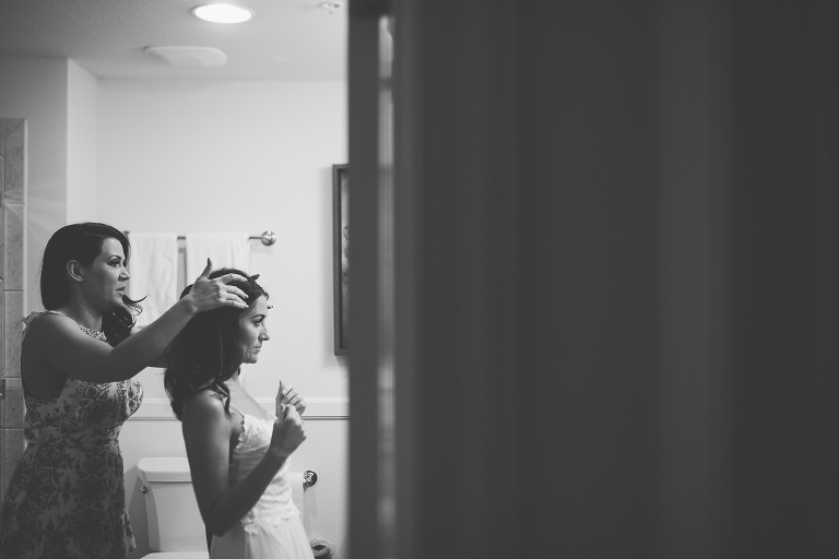 australian bride getting her hair and makeup done