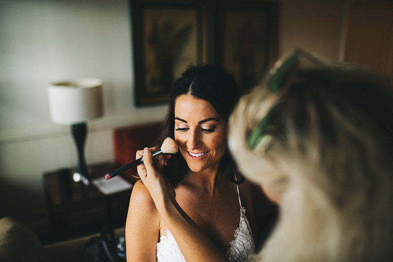 australian bride getting blush put on by laura reynolds