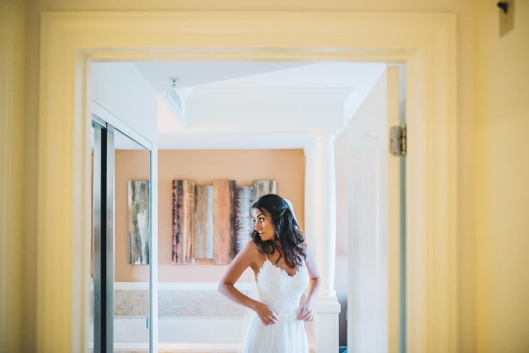 bride making final adjustments on her dress