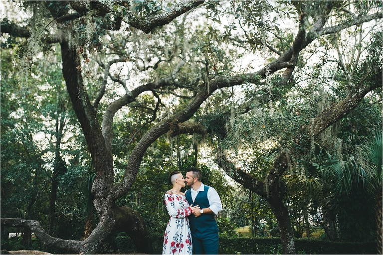 wide picture of couple and trees in the background