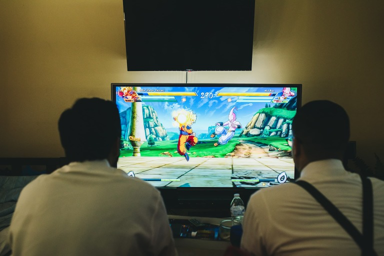 groom and groomsmen playing dragon fighter z